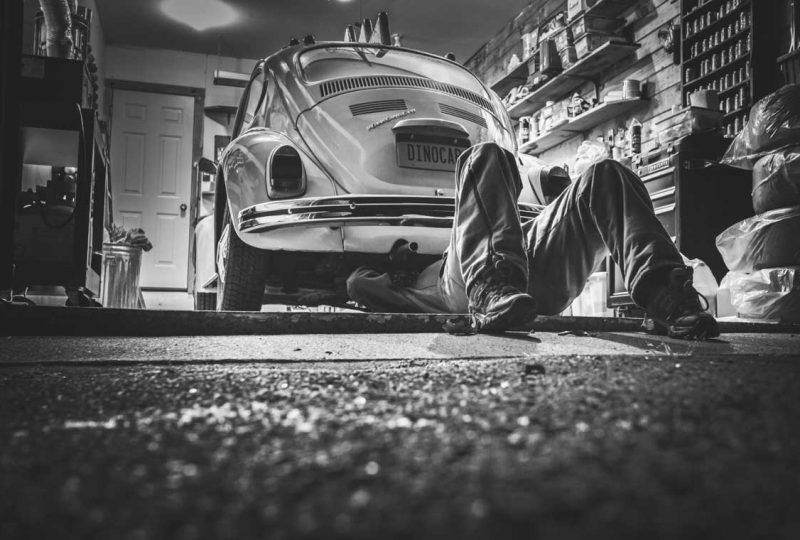 Man fixing a VW Bug